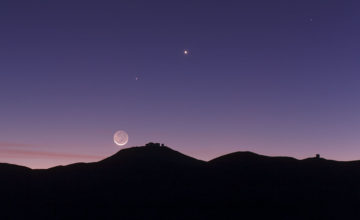 This view shows the thin crescent Moon setting over ESO's Paranal Observatory in Chile. As well as the bright crescent the rest of the disc of the Moon can be faintly seen. This phenomenon is called earthshine. It is due to sunlight reflecting off the Earth and illuminating the lunar surface. By observing earthshine astronomers can study the properties of light reflected from Earth as if it were an exoplanet and search for signs of life. This picture was taken on 27 October 2011 and also records the planets Mercury and Venus.